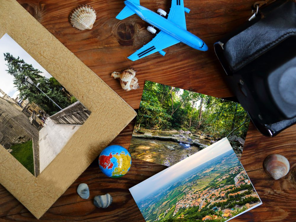 Camera, photos, globe and toy air plane. Travel concept