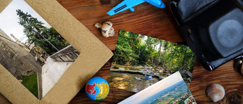 Camera, photos, globe and toy air plane. Travel concept