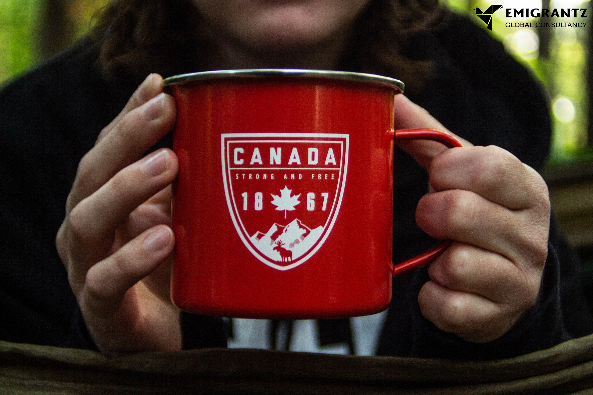 Person holding Canada labelled coffee mug